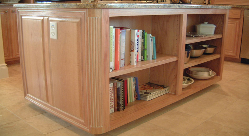 Burrows Cabinets Island in Red Oak with open shelving and integrated corners