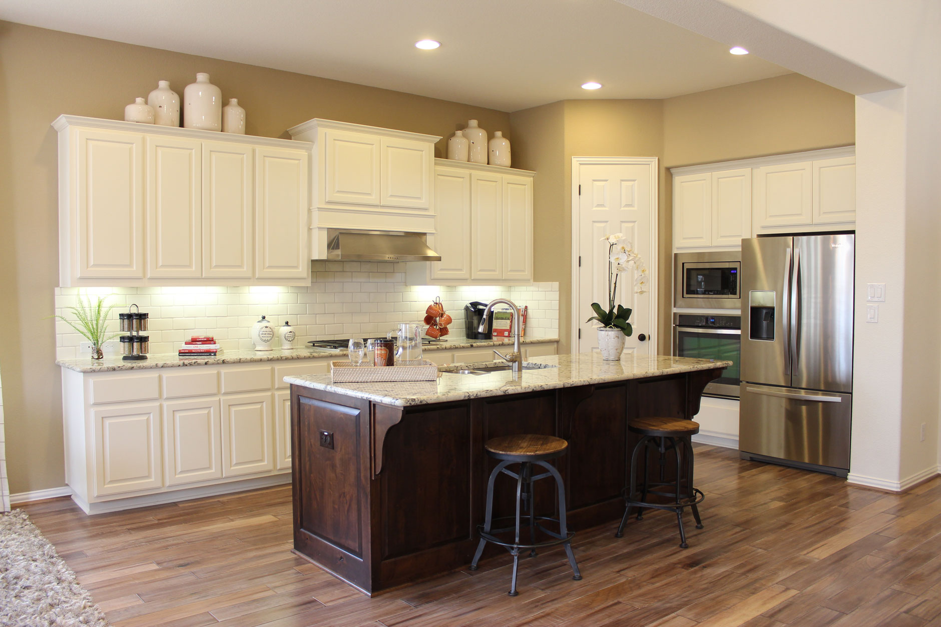 burrows cabinets kitchen in knotty alder with verona finish and appliance end panels - Choosing Kitchen Cabinet Colors