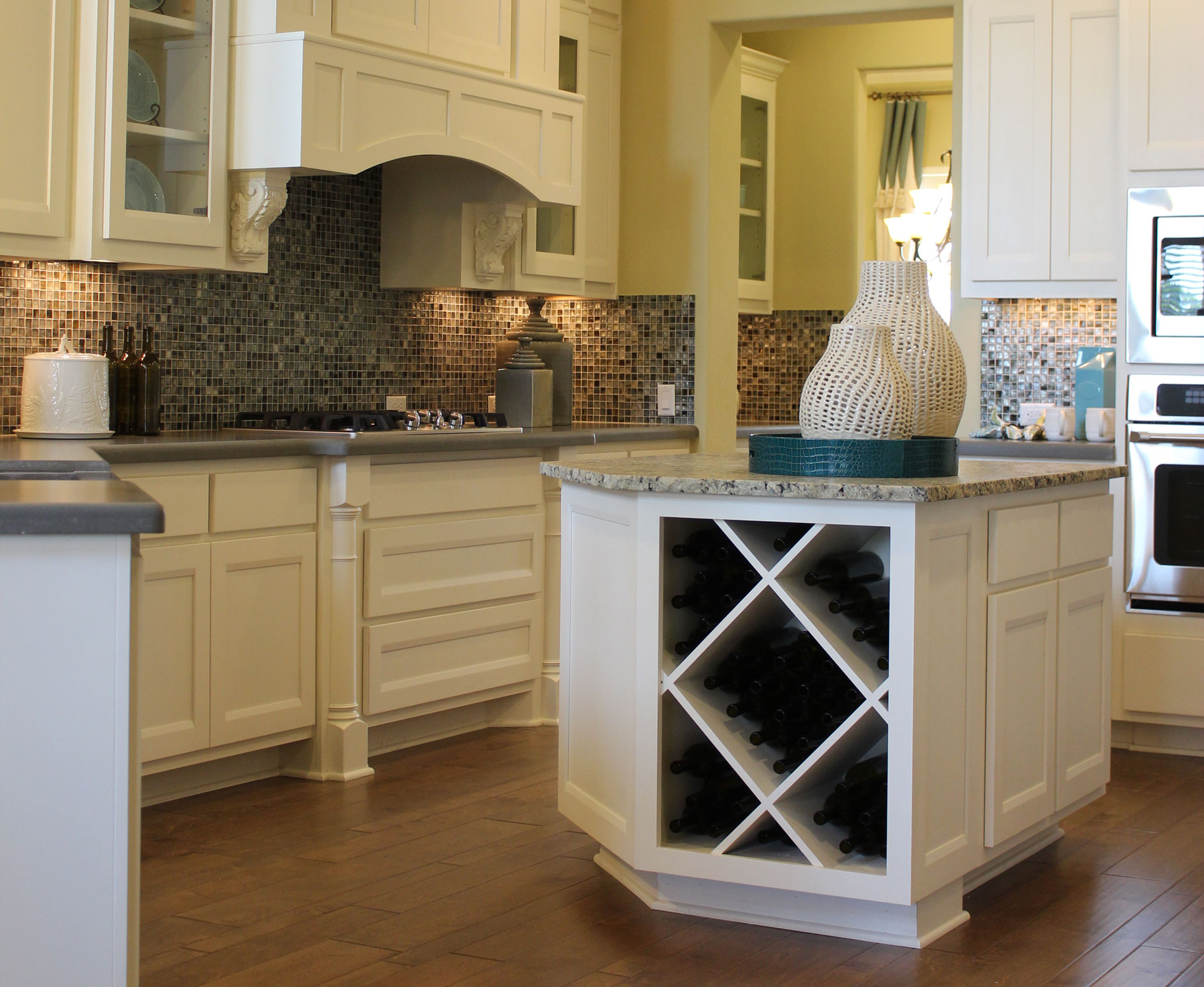 kitchen island with wine storage in Bone with Briscoe doors by Burrows Cabinets