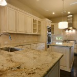 Burrows Cabinets kitchen in bone with brown glaze with glass doors and integrated corners