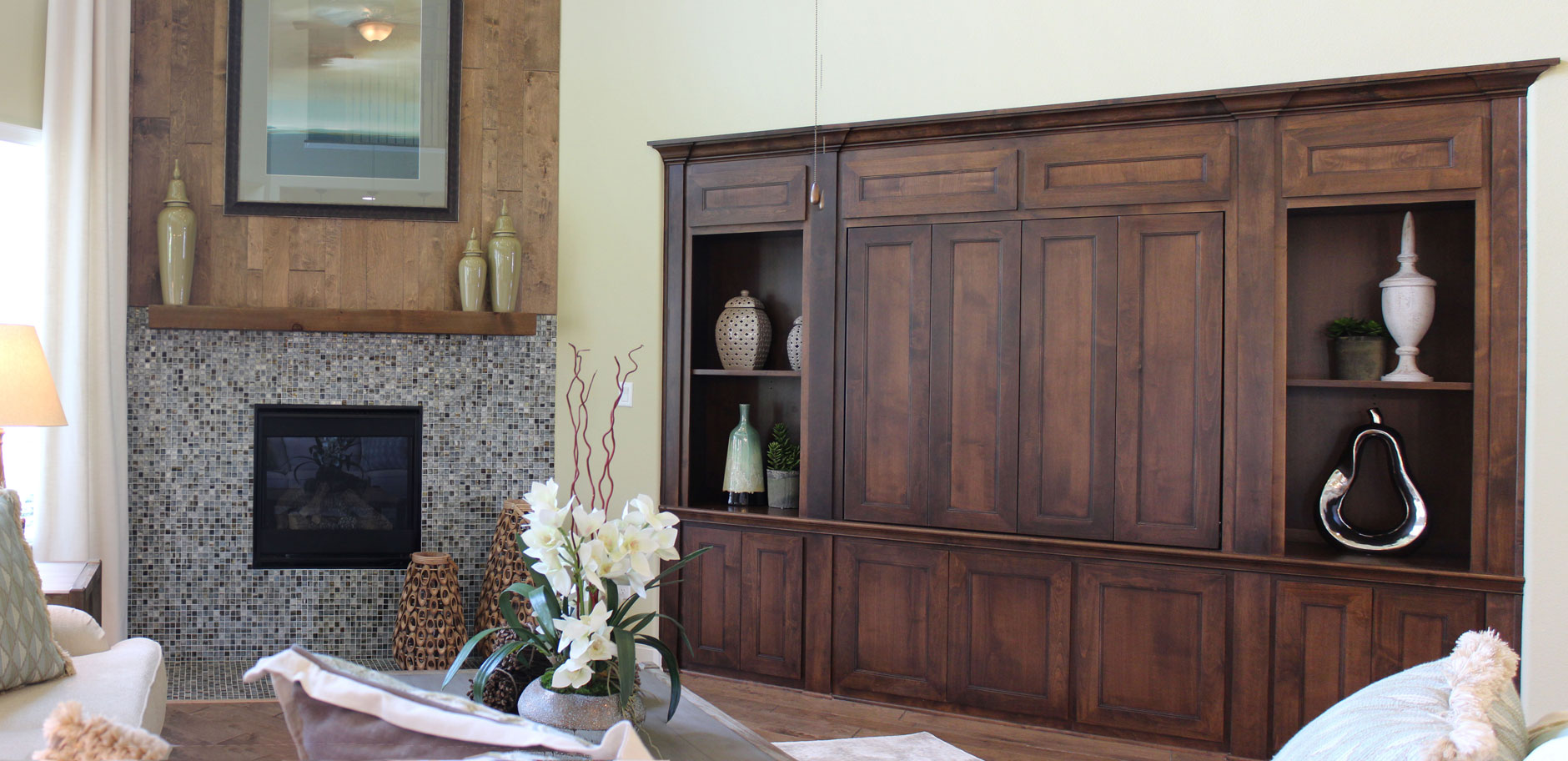 Travisso built in media cabinet entertainment center by Burrows Cabinets with Terrazzo doors