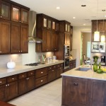 Kitchen cabinets by Burrows Cabinets with modern crown molding and Terrazzo doors