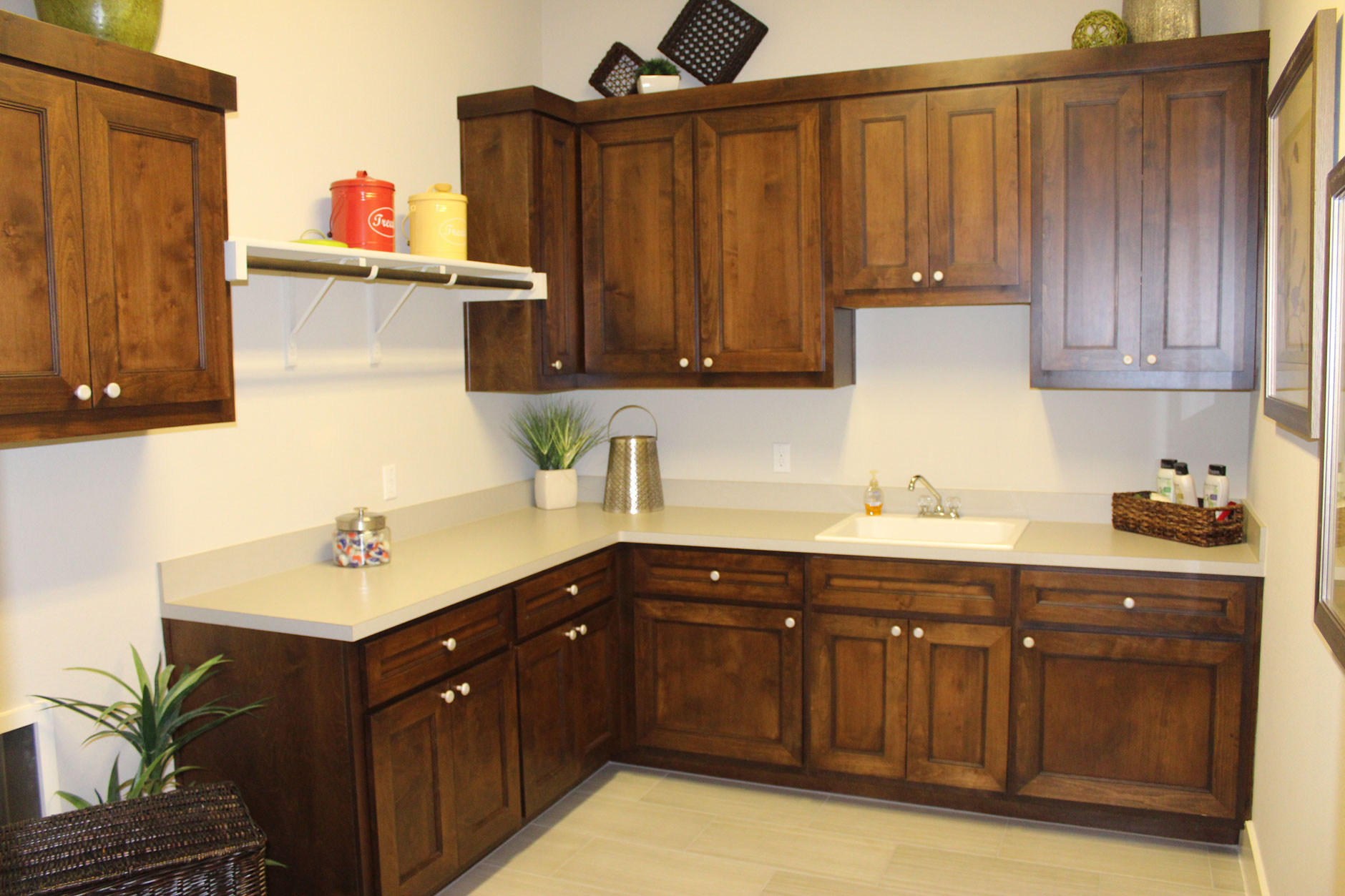 Laundry room cabinets by Burrows Cabinets with Terrazzo doors