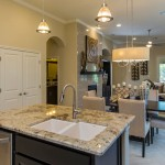 Burrows Cabinets kitchen cabinets in modern Briscoe design in Beech Rye with big X wine rack