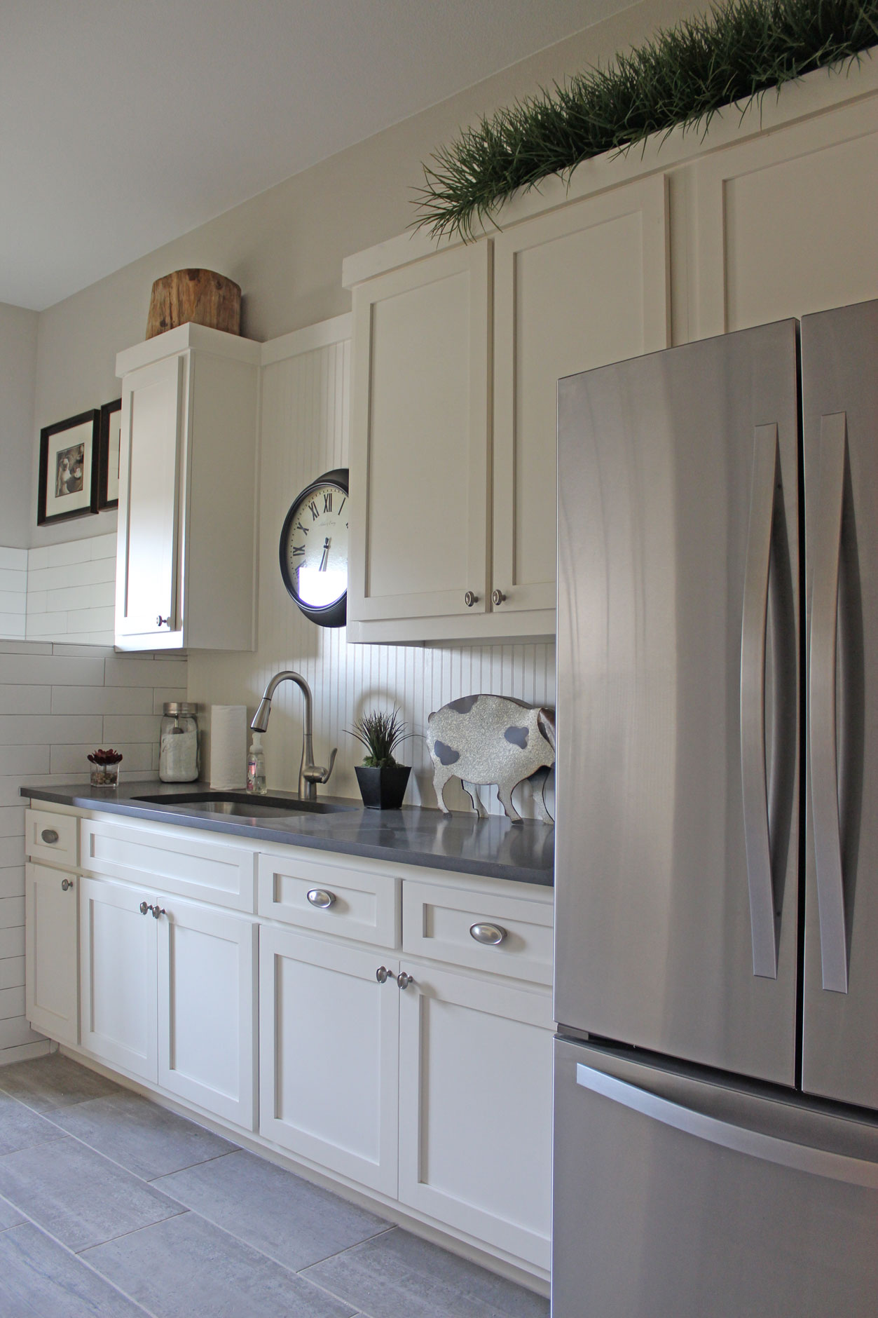 Laundry Room With White Beadboard Backsplash