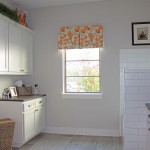 Burrows Cabinets white shaker laundry room cabinets with dog shower