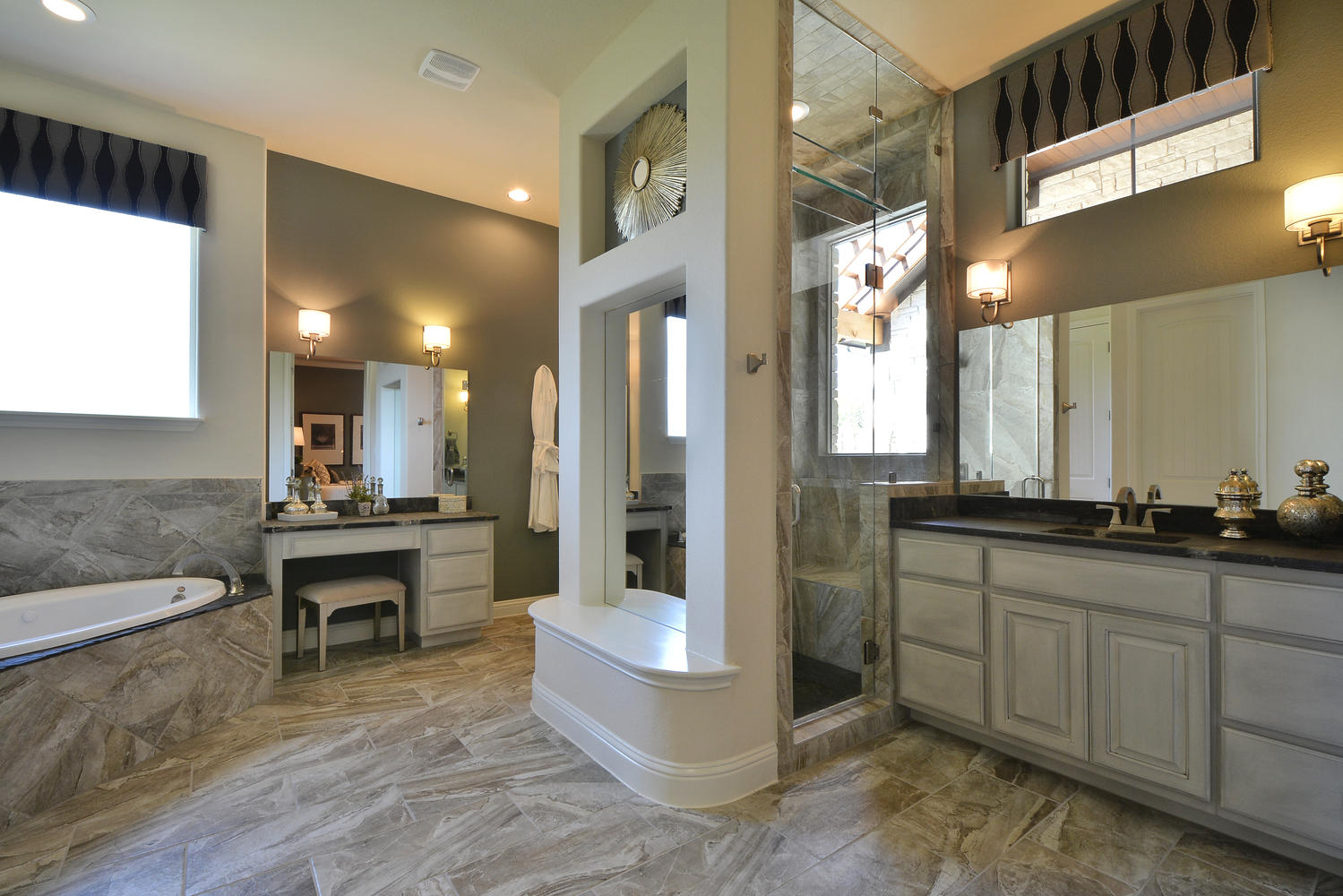 Burrows Cabinets master bath in bone with black glaze
