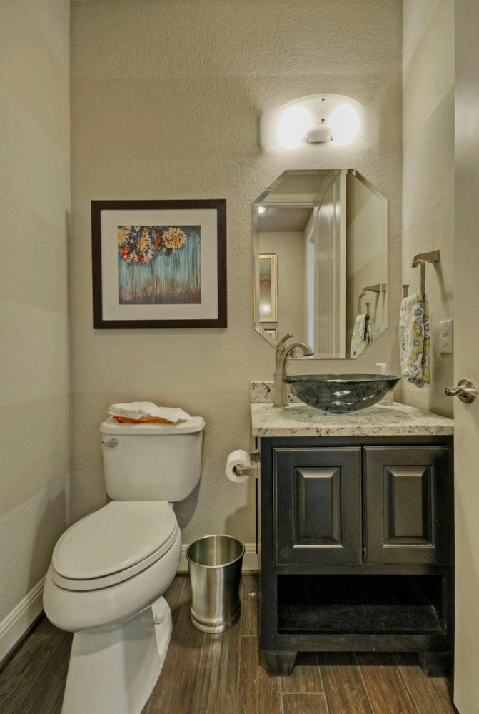 Powder room photos burrows cabinets central texas for Powder bathroom vanities