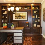 Burrows Cabinets' study with built in cabinets and bookshelves in stained Alder