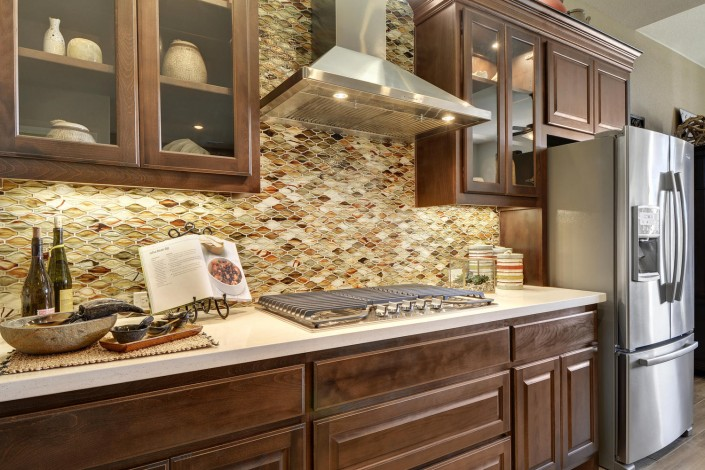 Burrows Cabinets' Beech wall cabinets in Kona stain with glass door inserts