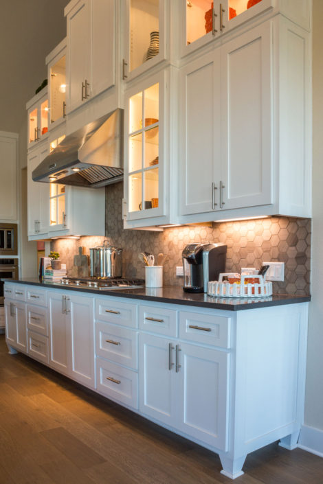 Burrows Cabinets' kitchen with mullion doors, Shaker doors in Bone white and Dallas feet