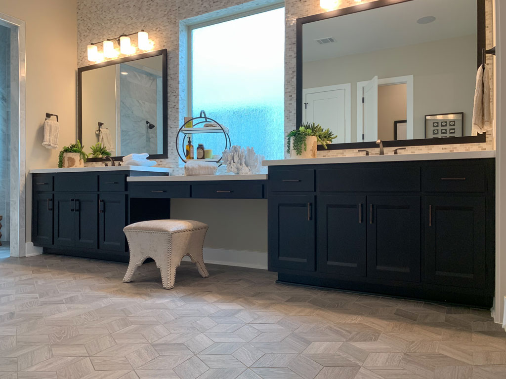 Master bathroom cabinets in Beech Espresso by Burrows Cabinets with Briscoe doors