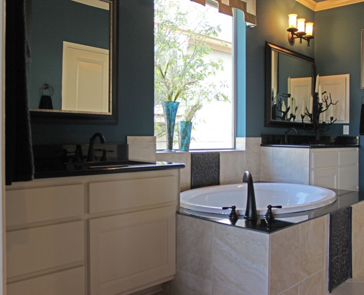 Burrows Cabinets' master bath cabinets in Bone with Briscoe doors