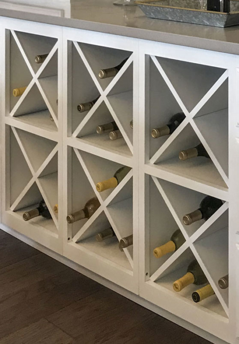 Six Big X wine racks together in dining hutch