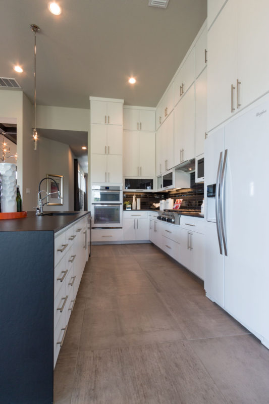 Burrows Cabinets' full overlay kitchen with modern white SoCo doors