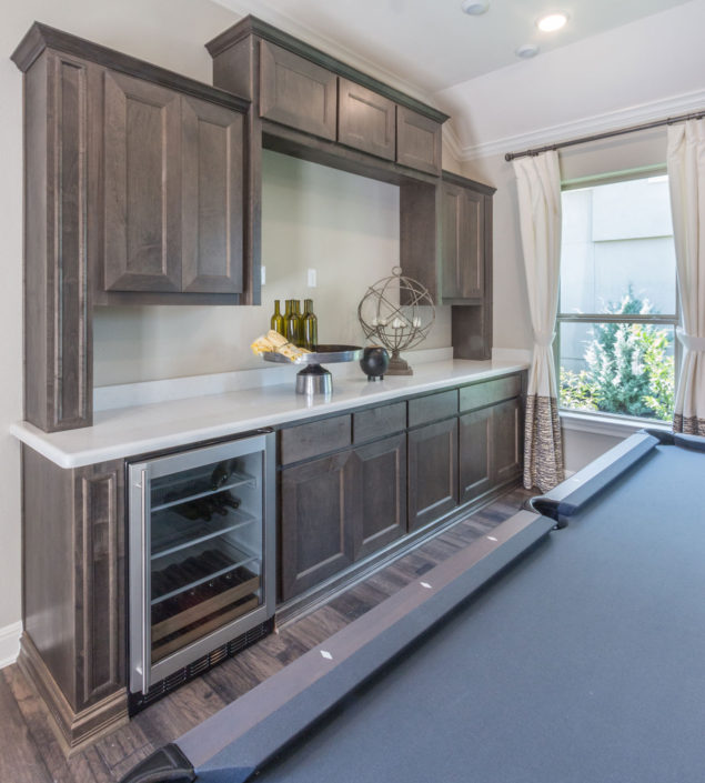 Built-in game room cabinets in Maple Driftwood