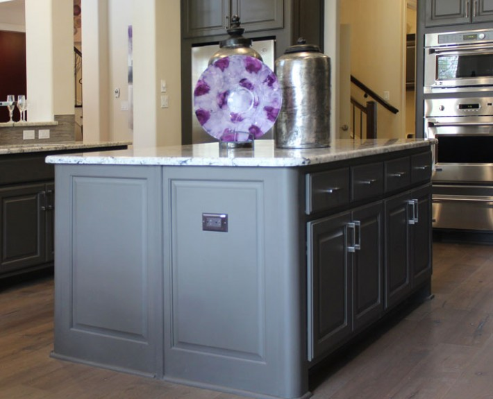 Burrows Cabinets kitchen island in Umber with rounded integrated corner option