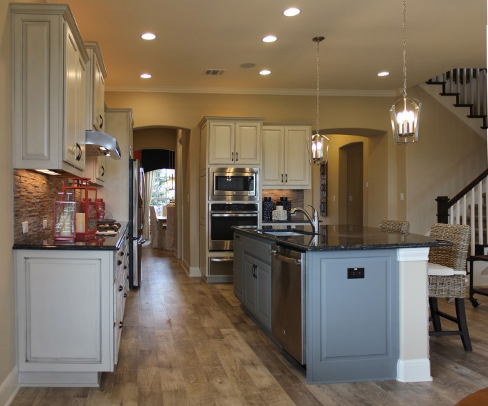 Burrows Cabinets kitchen with Ash gray island and perimeter cabinets in bone with black glaze