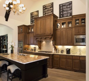 Burrows Cabinets' kitchen cabinets with raised panel doors in Maple Toffee