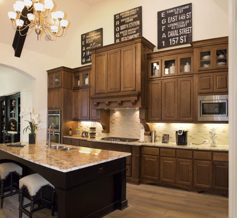Burrows Cabinets' kitchen cabinets with raised panel doors in custom Maple stain