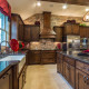 Burrows Cabinets' kitchen in Alder with Terrazzo doors and Classic wood vent hood