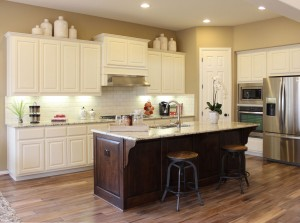 White perimeter cabinets and knotty alder island by Burrows Cabinets