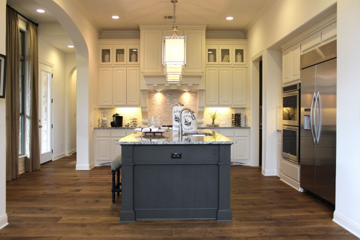 Burrows Cabinets' kitchen cabinets in bone white with umber gray island