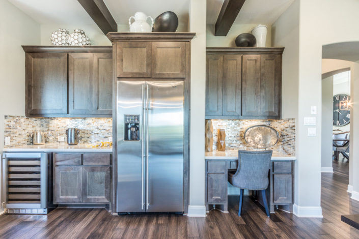 Built-in kitchen desk cabinets in Maple Driftwood