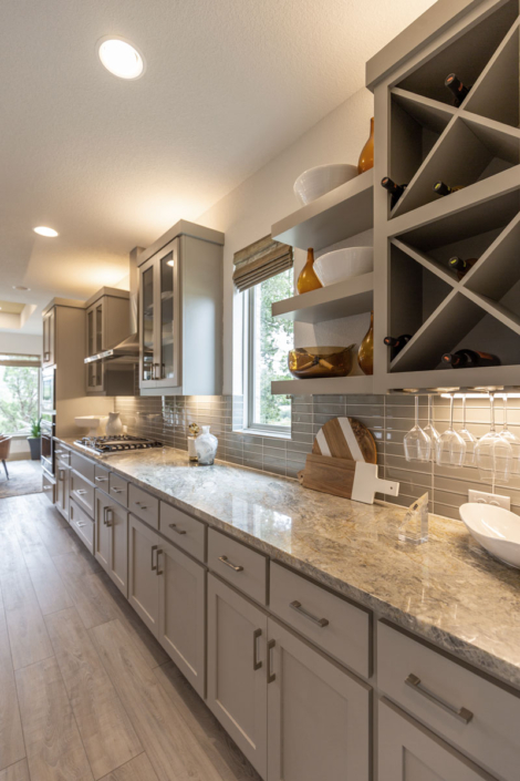 Wall cabinets with floating shelves and Big X wine rack