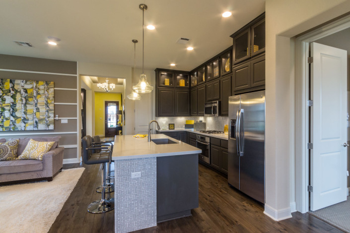 Burrows Cabinets' gray kitchen with raised panel doors
