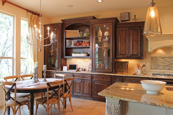 Burrows Cabinets kitchen hutch with glass doors, mullions and corner posts in stained knotty alder