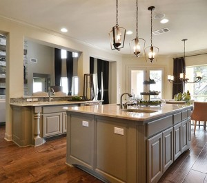 Burrows Cabinets kitchen island with Monaco posts and center island with integrated corners