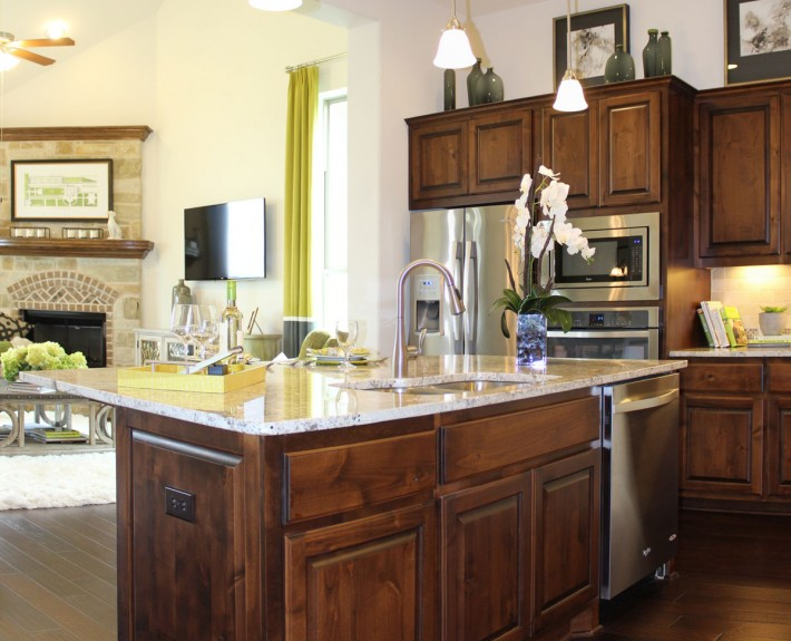 Burrows Cabinets' kitchen island in knotty alder with paneled ends
