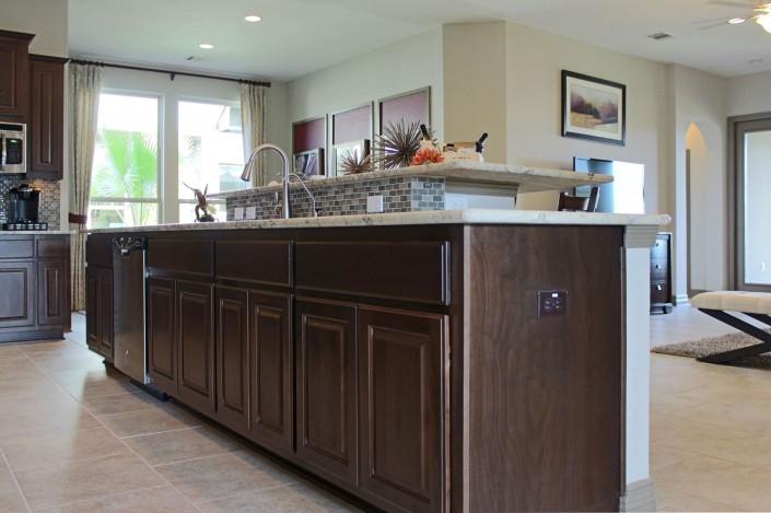 Burrows Cabinets kitchen island in Kona with raised eat in breakfast bar