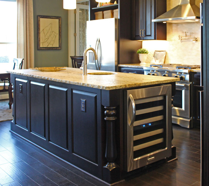 Burrows Cabinets kitchen island with Monaco Posts and wine refrigerator