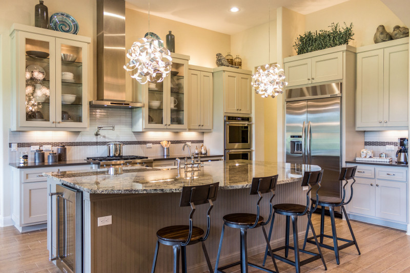 Burrows Cabinets' white kitchen cabinets with Kensington doors and glass inserts in uppers