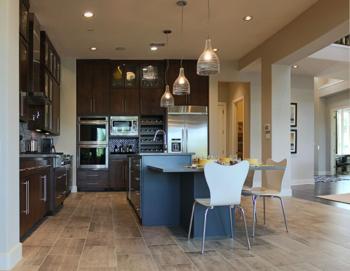 Burrows Cabinets kitchen with modern, stained alder cabinets, gray island and SoCo doors