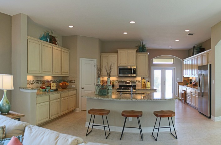 Burrows Cabinets kitchen in bone with brown glaze