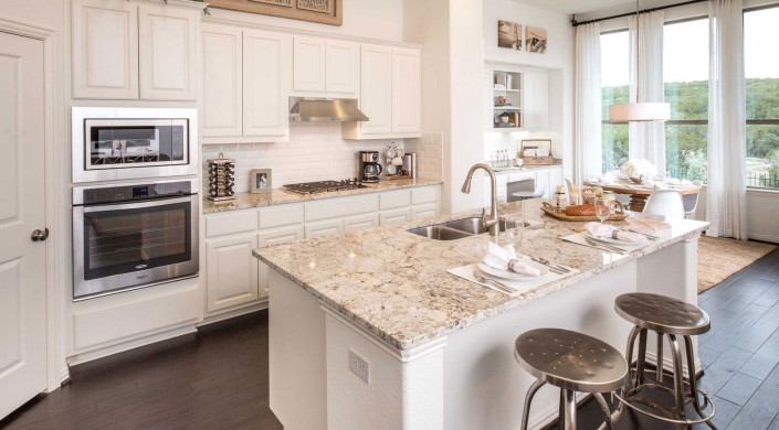 Burrows Cabinets' kitchen cabinets in Bone white with raised panel doors