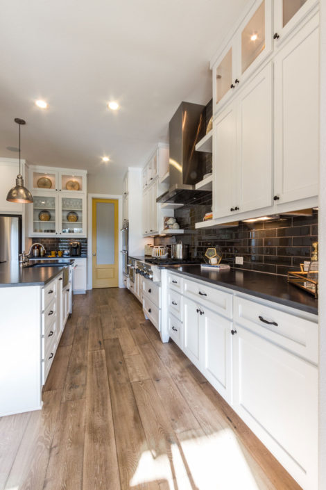 Burrows Cabinets' kitchen island with Shaker doors in Bone white
