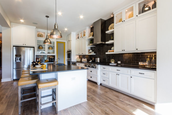Burrows Cabinets' kitchen with Shaker doors in Bone white, floating shelves and glass