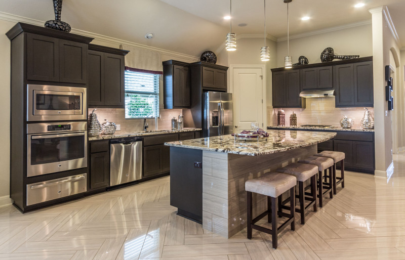 Burrows Cabinets kitchen with shaker style cabinets in Umber gray
