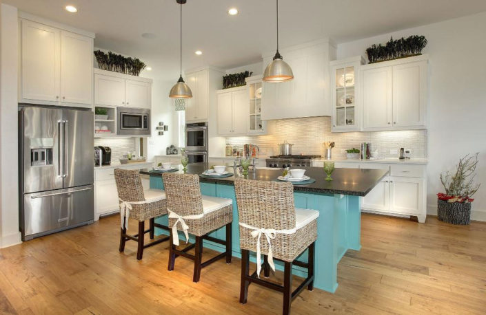 Burrows Cabinets kitchen with shaker doors in white and turquoise
