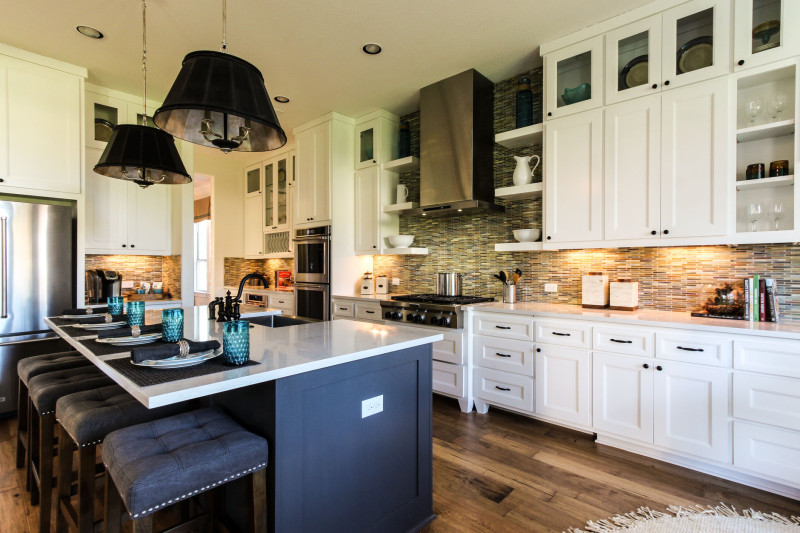 High End Kitchen Cabinets 1. Burrows Cabinets White Kitchen With Gray Island And Terrazzo Doors