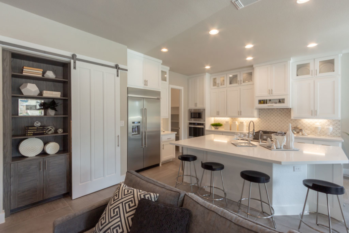 Kitchen in Frost white with Terrazzo doors and barn door and hidden bookshelves