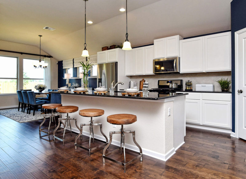 Kitchen with shaker style cabinets in white by Burrows Cabinets