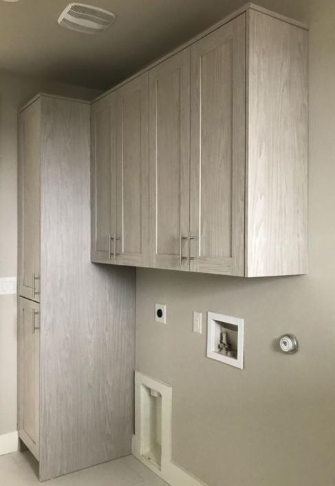Laundry room cabinets in EVRGRN Artisk