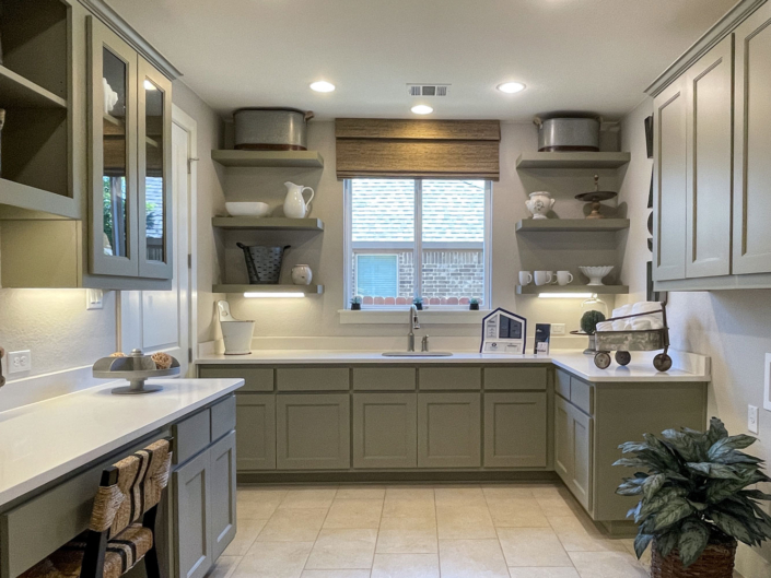 Laundry room cabinets with floating shelves and desk
