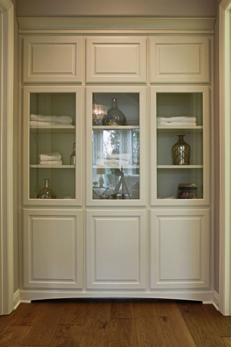 Burrows Cabinets' linen cabinets with glass doors in bone white