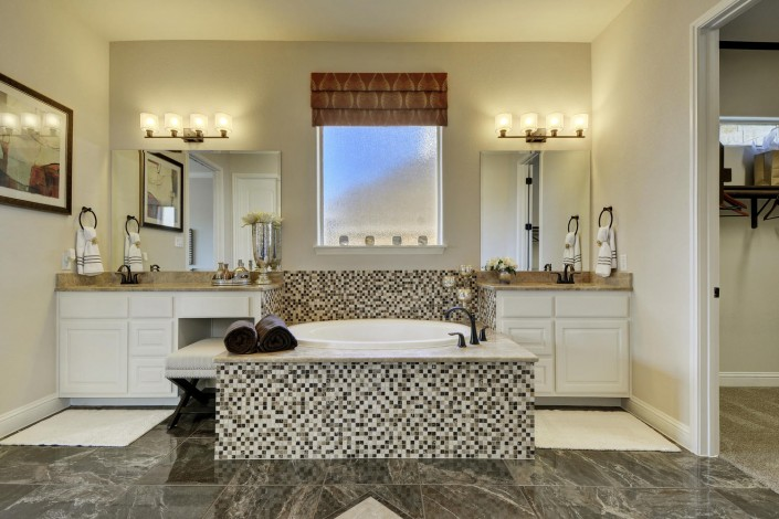 Burrows Cabinets' master bath in bone with knee space